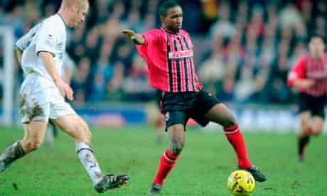 Bournemouth's Jermaine Defoe keeps the ball away from Millwall's Sean Dyche