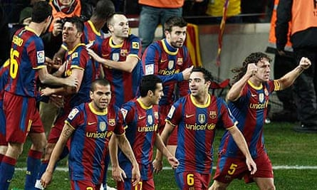 Barcelona's players celebrate during the 5-0 hammering over Real Madrid