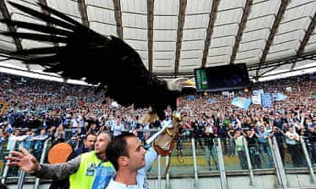 Lazio's mascot, Olimpia the eagle, is paraded around the Olympic stadium before the Rome derby