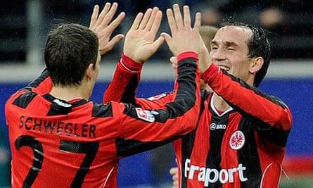 Frankfurt's Theofanis Gekas, right, and Pirmin Schwegler celebrate during the win over Wolfsburg