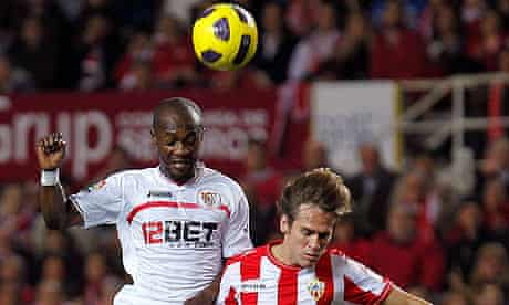 Didier Zokora jumps for the ball during Sevilla's defeat at the hands of Almería