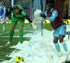 Football white-outs: West Ham's Carlton Cole plays in the snow with Blackburn's Paul Robinson