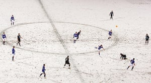 The players attempt to deal with the conditions at Portman Road during Ipswich Town's game against Leicester City in December 2010