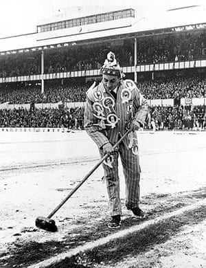 Football white-outs: A Spurs fan sweeps the snow from the lines