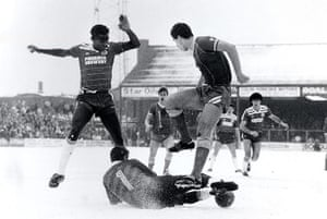 Football white-outs: Brighton and Peterborough play on a snow covered pitch