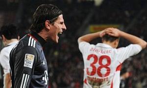 Bayern Munich's Mario Gomez scores against Stuttgart