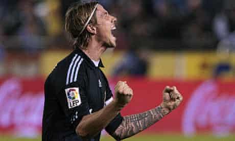 Guti celebrates Karim Benzema's goal