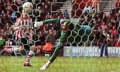 Southampton's Adam Lallana has a header saved by Portsmouth's David James