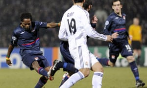 Lyon s Cameroon international midfielder Jean Makoun drives home a goal  just after half-time against Real Madrid. Photograph  Philippe  Merle AFP Getty ... 134ae6073