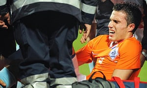 Arsenal forward Robin van Persie injured playing for Holland against Italy in November 2009