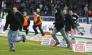 Hertha Berlin fans invade the pitch after their defeat to Nurnberg