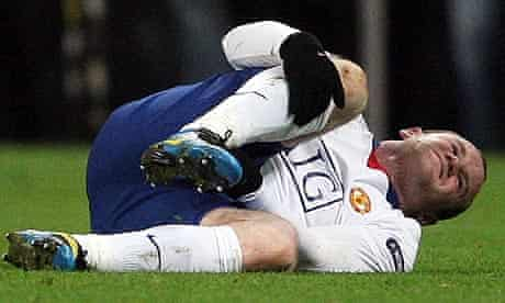 Manchester United's Wayne Rooney lies on the floor