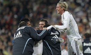 Rafael Van der Vaart is mobbed by his Real Madrid team-mates after scoring  their winner against Sevilla. Photograph  Victor R. Caivano Associated Press ec4f4e017aac3