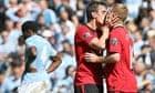 Gary Neville kisses Paul Scholes after Scholes scores United's winner against City