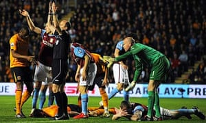 Hull City's Jan Vennegoor of Hesselink and Aston Villa's Richard Dunne after a collision