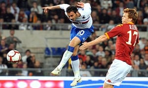 Giampaolo Pazzini heads the ball past Roma's John Riise