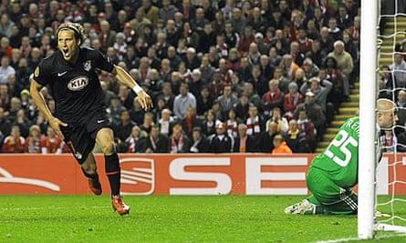 Diego Forlan celebrates scoring against Liverpool