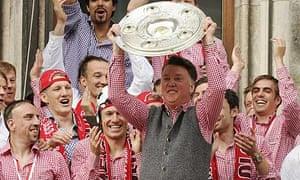 Bayern Munich coach Louis van Gaal and his team celebrate their Bundesliga title at the Marienplatz