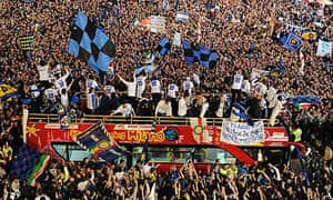Inter players and staff celebrate on a bus in Duomo square, Milan, after their Serie A title win