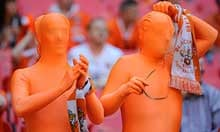 Blackpool fans in skin suits take in the scene at Wembley