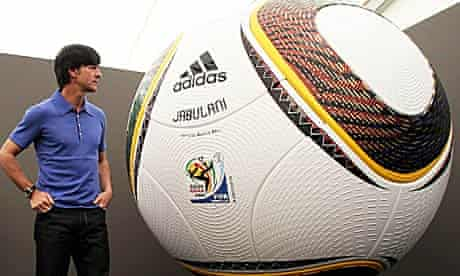 Joachim Loew of Germany is pictured in front of the official World Cup match ball, the Jabulani