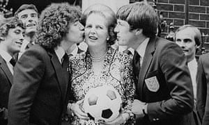 England footballers Kevin Keegan and Emlyn Hughes, kissing the prime minister Margaret Thatcher