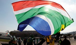 Fans wave a South African flag at Soccer City in Johannesburg