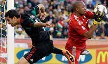 South Africa goalkeeper Moeneeb Josephs blocks a scoring chance for Mexico's Rafael Marquez