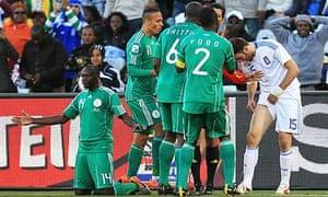 Vassilis Torosidis of Greece shows Nigeria players the mark on his leg after a tackle by Sani Kaita