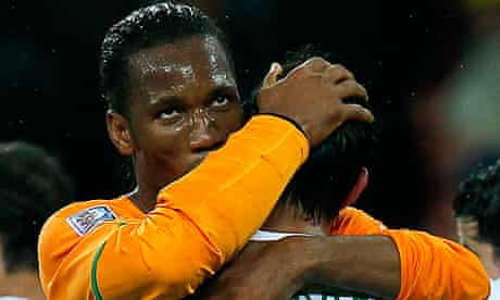 Ivory Coast's striker Didier Drogba in a cast with Portugal's Paulo Ferreira