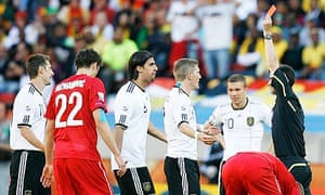 Germany's Miroslav Klose, far left, is sent off by referee Alberto Undiano against Serbia