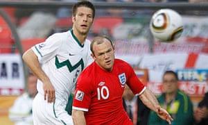 England's Wayne Rooney runs for the ball in front of Slovenia's Bostjan Cesar