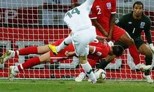 John Terry dives in front of a shot by Slovenia's striker Zlatko Dedic