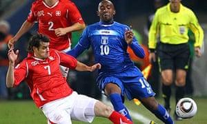 Switzerland's Tranquilo Barnetta tackles Honduras's Julio Cesar, World Cup 2010