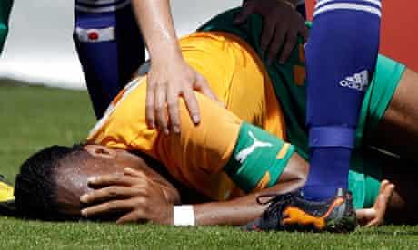 Japan's Tulio checks on Ivory Coast's Didier Drogba