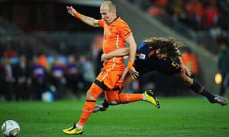 Arjen Robben and Carles Puyol