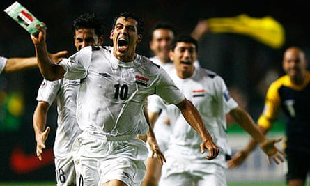 Iraq captain Younis Mahmoud celebrates after he scored against Saudi Arabia at the Asian Cup final