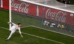 Uruguay goalkeeper Fernando Muslera can only watch Giovanni van Bronckhorst's exocet
