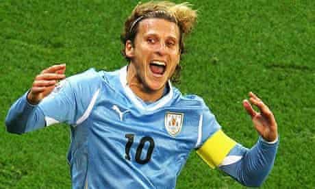 Diego Forlan of Uruguay celebrates
