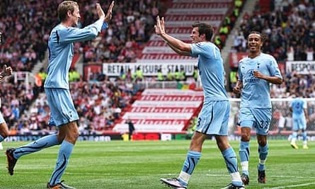Tottenham Hotspur's Gareth Bale, right, celebrates with Peter Crouch after scoring at Stoke City
