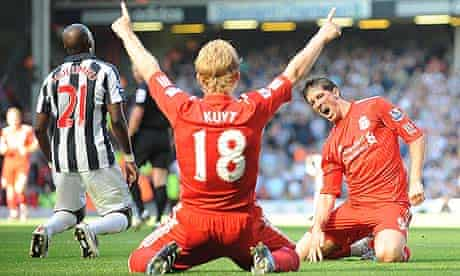 Liverpool's Fernando Torres celebrates with Dirk Kuyt