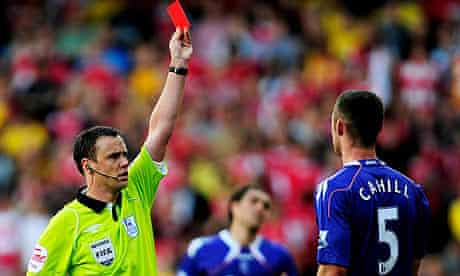 Stuart Attwell shows Gary Cahill of Bolton a red card