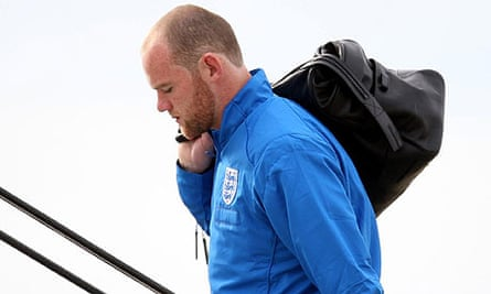 Wayne Rooney boards a plane at Luton airport