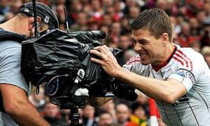Liverpool's Steven Gerrard shouts into a television camera