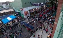 Fans milling about outside Fenway Park