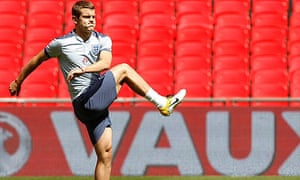 Jack Wilshere warms up for an England team training session at Wembley stadium in June