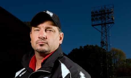 The Aldershot manager, Dean Holdsworth, poses