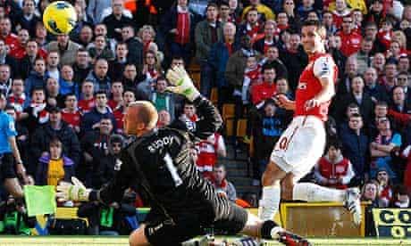 Arsenal's Robin van Persie scores his second goal against Norwich City
