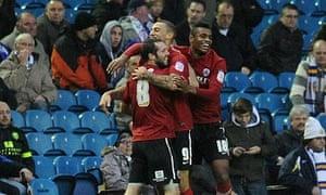 Barnsley's Craig Davies, centre, celebrates scoring his side's second goal against Leeds United