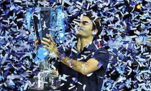 Roger Federer poses with the ATP World Tour Finals trophy